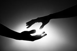 spiritual mentoring image of hands exchanging light